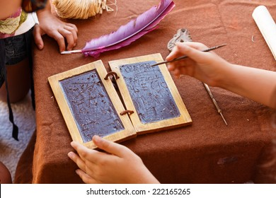 Wax tablets were developed by the Romans and Greeks. The tablets were blocks of wood with were coated in wax allowing them to be written upon using a stylus, and later  erased for re-use