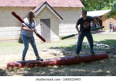 Waxahachie, Texas / USA - 11 May 2019 Scarborough Renaissance Festival Two young people in a jousting match with pugil sticks.