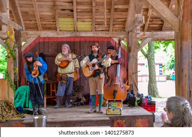 Waxahachie, Texas / USA - 11 May 2019 Scarborough Renaissance Festival A hillbilly band playing excellent folks music.
