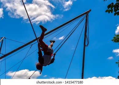 Waxahachie, Texas / USA - 11 May 2019 Scarborough Renaissance Festival A young girl on the bungy ride and obviously enjoying the thrill of the slingshot effect.