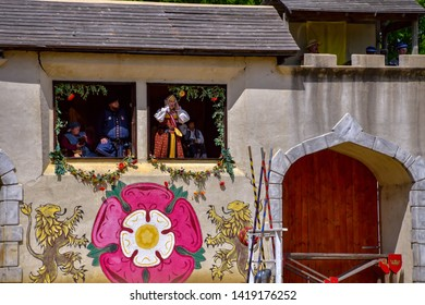 Waxahachie, Texas / USA - 11 May 2019 Scarborough Renaissance Festival People in period costumes reacting to the jousting games taking place.
