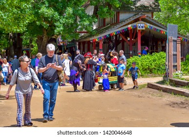 Waxahachie, Texas / USA - 11 May 2019 Scarborough Renaissance Festival Festival attendees strolling around in the village.