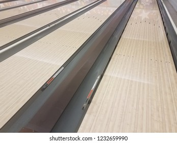 waxed wooden bowling alley lanes with bumpers