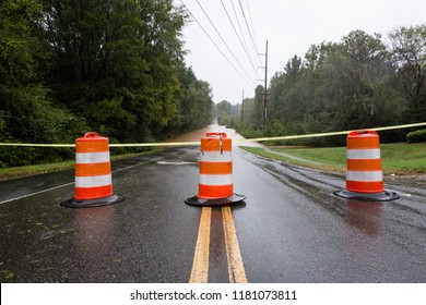 Waxhaw, North Carolina - September 16, 2018: Barricades block a roadway flooded by rain from Hurricane Florence