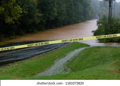 Waxhaw, North Carolina - September 16, 2018: Rainwater from Hurricane Florence floods a roadway