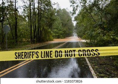 Waxhaw, North Carolina - September 16, 2018: Police block  the road after a bridge is washed out by rain from Hurricane Florence