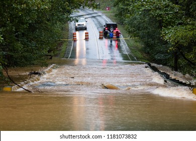 Waxhaw, North Carolina - September 16, 2018: Motorists inspect a road flooded by rain from Hurricane Florence