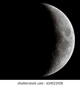 Waxing crescent Moon, taken with a professional astronomical telescope. Lots of details in the craters, with some subtle colors, too.