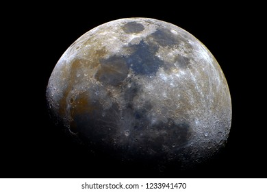 Waxing gibbous mineral Moon taken at 1500 mm with telescope, with its natural colors and craters details, isolated in dark background on space.