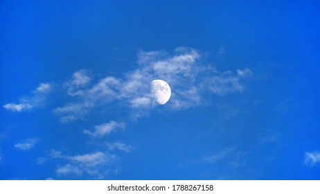 Waxing Gibbous Moon Behind Whispy Clouds
