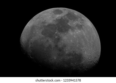 Waxing gibbous Moon taken at 1500 mm with telescope, with craters details on the shadow part, isolated in dark background on space.