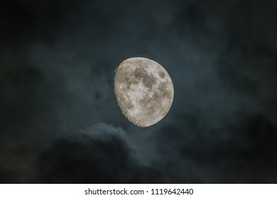 Waxing Gibbous phase moon during cloudy night
