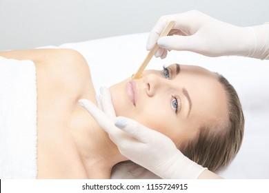 Waxing woman leg. Sugar hair removal. laser service epilation. Salon wax beautician procedure.