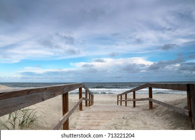Way to the beach. Ocean beach view.Marine landscape with wooden boardwalk leads to the atlantic ocean beach. Pawleys Island, Myrtle Beach area, South Carolina USA.