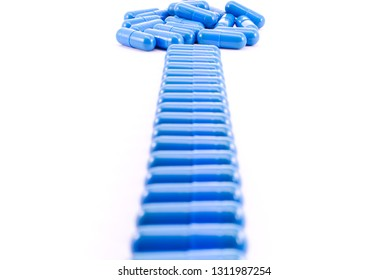 Way from blue capsules on white. Way for safer medicine.