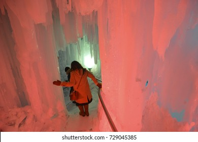 Way down in the Ice cave Illuminated icicle with tourist at Snow Festival Sapporo, Hokkaido, japan