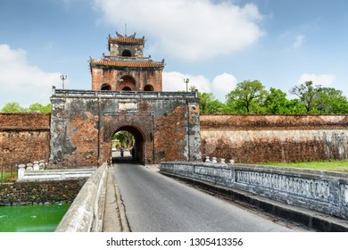 Way to the Imperial City with the Purple Forbidden City through the Ngan Gate in fortress wall of the Citadel in Hue, Vietnam. Hue is a popular tourist destination of Asia.