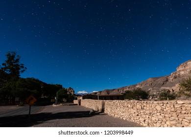 Way to Paniri volcano at Atacama desert in the night sky