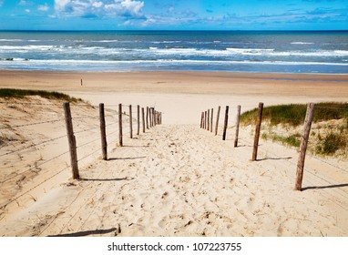 way to the sand beach on North sea in Netherlands