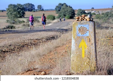 Way of St James , Camino de Santiago , sign shells marks for pilgrims to Compostela Cathedral ,Galicia, Spain - Cammino ( Walk of Santiago )  Pilgrims with backpackers are walking along the pilgrimage
