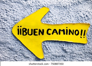 way st James to Compostela ,  yellow arrow sign  with the greeting among pilgrims  Good road , Buen Camino  in spanish language