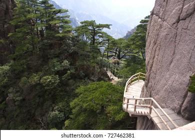The way up , Stone Steep Steps . Trekking walking hiking Huangshan Mountain. Anhui, China. 13th , April 2009