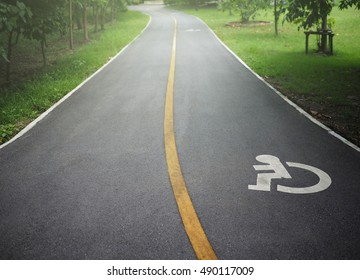 way of wheel chair in the park/disabled icon sign on the road in the public park