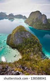 The Wayag islands in Raja Ampat, Indonesia, are surrounded by warm, clear waters that support healthy coral reefs.  This region is known for its high marine biological diversity and great diving.