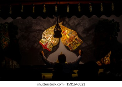 wayang kulit or shadow puppets from Java, Indonesia puppet show by dalang or puppeteer . Wayang made from leather wayang gunungan