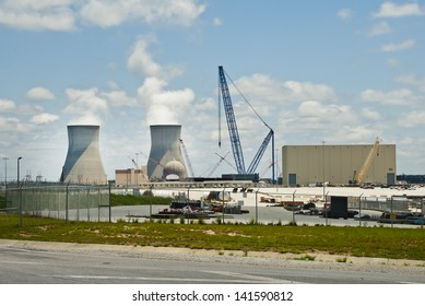 WAYNESBORO, GEORGIA - JUNE 6: White steam flows from the huge, 548 foot, cooling towers, that rise over the reactor  at Vogtle Electric Generating Plant. June 6, 2013 near Waynesboro, Georgia.