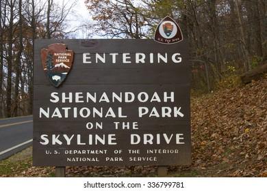 Waynesboro, VA, USA - November 6, 2015 : Sign for entering Shenandoah National Park and Skyline Drive on autumn day.