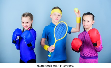 Ways to help kids find sport they enjoy. Friends ready for sport training. Sporty siblings. Child might excel completely different sport. Girls kids with boxing sport equipment and boy tennis player.