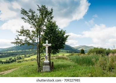 a wayside cross in the middle of summer countryside