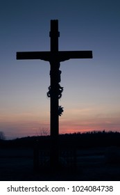 wayside cross at sunset