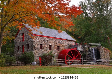 The Wayside Inn Grist Mill with water wheel and cascade water fall in Autumn., Sudbury Massachusetts USA