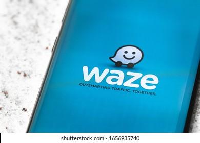 Waze, app, screen, cellphone. Photograph of Waze app screen for smartphone. Waze is a famous GPS use app for traffic. Brasilia, Federal District - Brazil. February, 26, 2020.