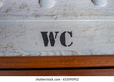 WC sign on cabin door on traditional sailing ship