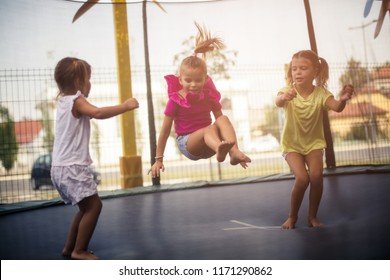 We are always one with the other. Three little happy girls spending time together in playground. Close up. Copy space.