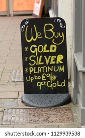 We Buy - Gold, Silver and Platinum sign outside pawnbrokers