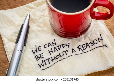 We can be happy without reason - inspirational words - handwriting on a napkin with cup of coffee