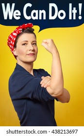 We can do it text bubble in photo of a self-confident woman rolling up her sleeve, perfect tribute to the classic american poster of rosie the riveter, icon of women's lib movement
