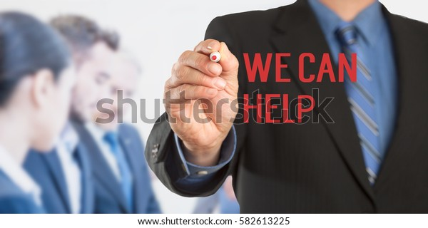 We Can Help, Male hand in business wear holding a thick pen writing, with office team blurred in background, digital composing.