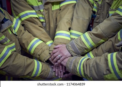 """We can, we will, we must. Members of the fire department clash their hands and show that they are a strong group"