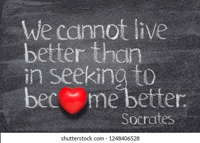 We cannot live better than in seeking to become better - quote of ancient Greek philosopher Socrates written on chalkboard with red heart symbol instead of O