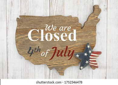 We are closed 4th of July wood sign of US map with retro star on weathered whitewash wood