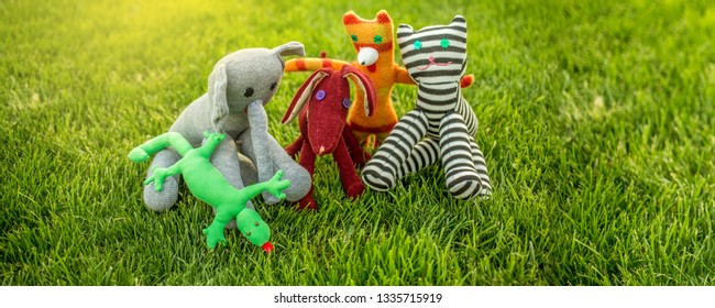 We are different, we are friends concept. Happy friendship day banner with diverse toy friends hugging together