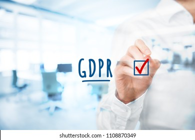 We are done, GDPR is implemented. Businessman or IT technologist is ready to GDPR. He ticks a finished job in checklist around GDPR including implementation. Double exposed with office in background.