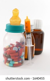 Are we feeding the children too much drugs? Pills in a bottle to represent feeding children medication.
