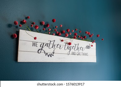 we gather together and give thanks sign on the wall