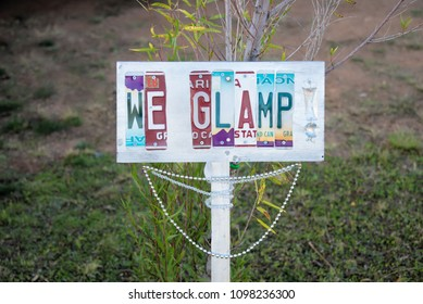 """We Glamp"" sign made from cut up license plates"